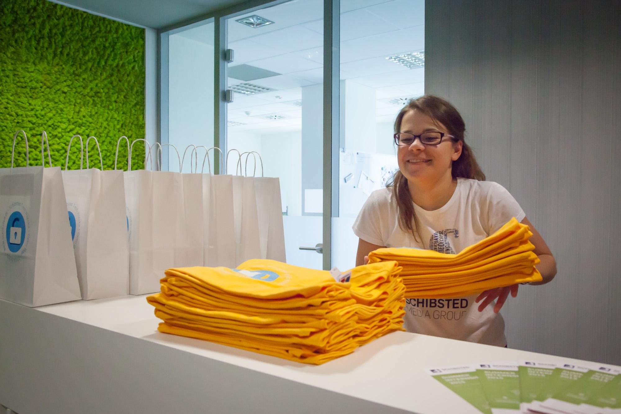 Recruiter Aleksandra Niemyska is getting T-shirts ready for the students