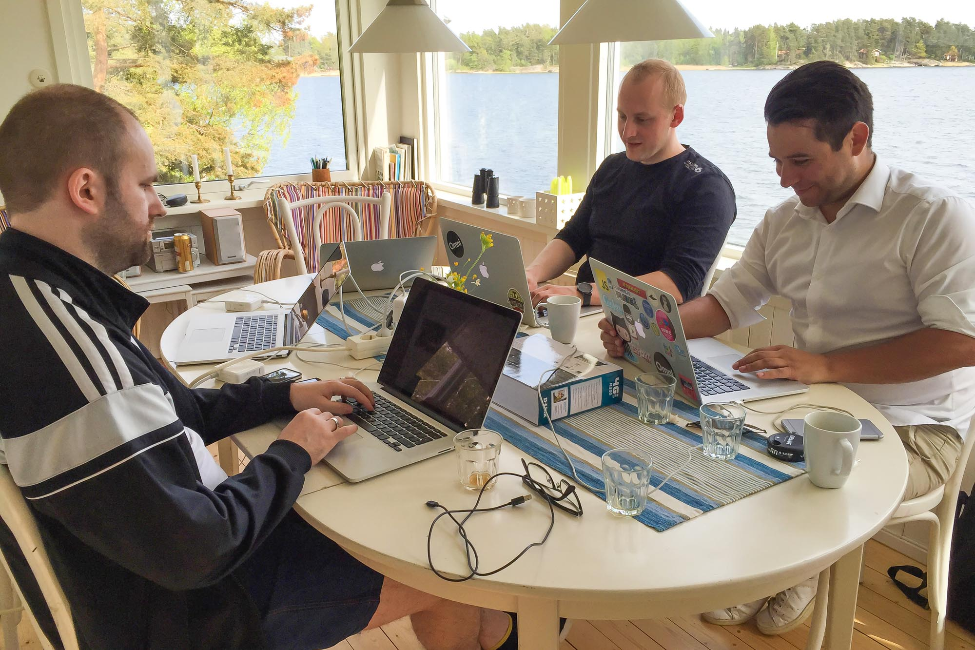 Coding by the sea in Sweden! From left Android developer Damian Petla, iOS developer Michal and tech lead Alexander Nordström