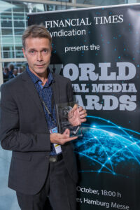 """Editorial product manager Even Teimansen in Aftenposten with the """"Best in tablet publishin"""" award"""