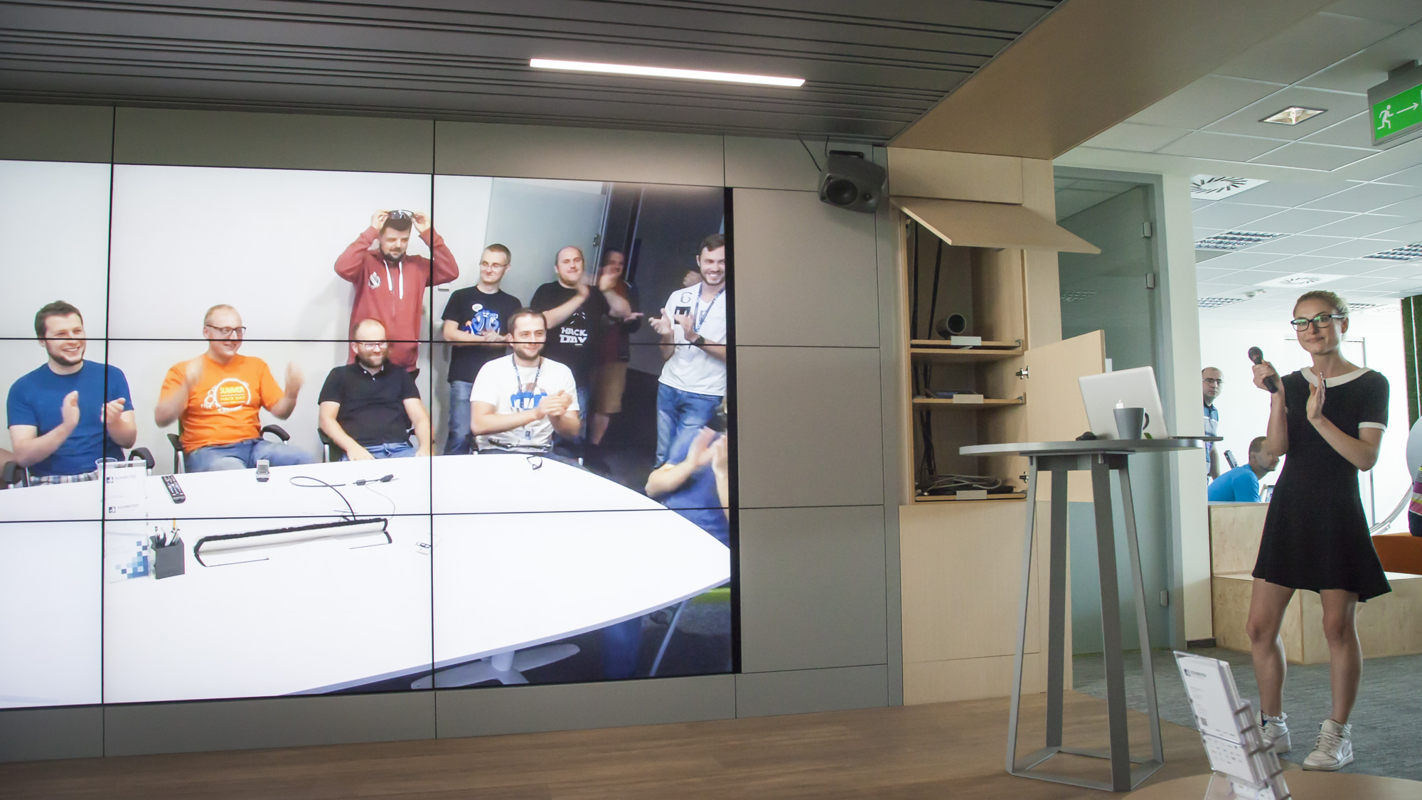 The team in the Gdansk office cheers as one of their projects is declared the winner