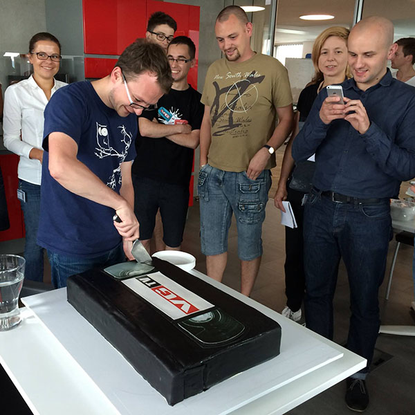 Team leader Konrad Pietrzkiewicz cuts the specially decorated cake to celebrate the launch of the new video platform