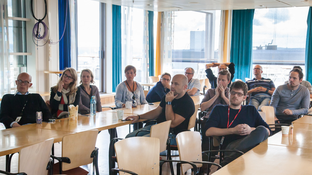 Developers in Aftenposten, VG and Schibsted Norge Digital listening to presentations from STP´s summer interns. Photo: John Einar Sandvand