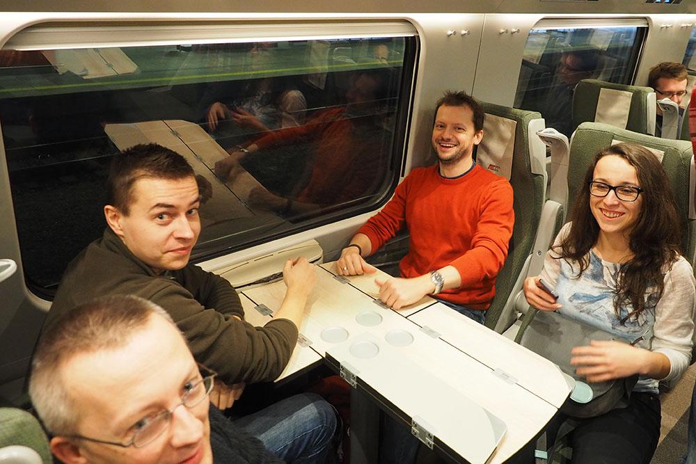 Tomasz Zakrzewski,  Przemysław Kuliga, Bartosz Chucherko and Ewa Boryło on the Pendolino train going to the Winter Event.